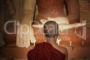 Buddhist novices lighting up candlelight