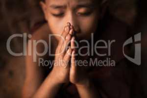Buddhist novice monks praying in temple