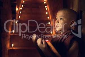 Buddhist novice monk learning in monastery