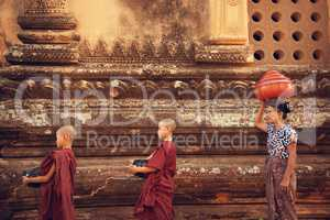 Buddhist novice monks collect alms