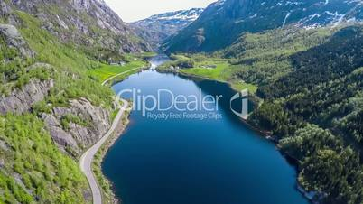 Aerial footage Beautiful Nature Norway. Flying over the lakes and fjords.View from the bird's-eye view. 4K ULTRA HD.