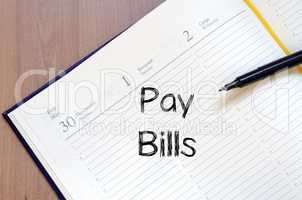 Pay bills write on notebook