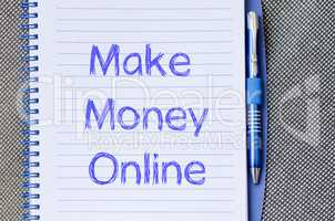 Make money online write on notebook