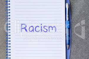 Racism write on notebook