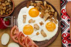 Scrambled eggs with bacon from pork fat