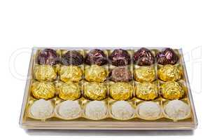 Chocolate sweets in the box on the white background.