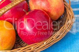 Large apples in a wattled basket.