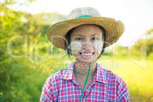 Traditional young Burmese female farmer