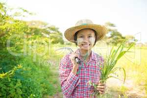 Traditional young Myanmar female farmer