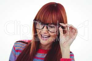 Smiling hipster woman doing a wink
