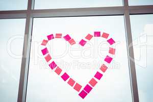 Heart in post-it on a window