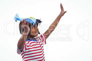 Smiling boy playing with toy airplane