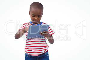 Standing boy using tablet