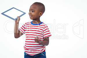 Standing boy holding tablet