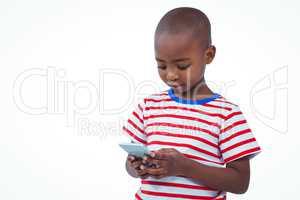 Standing boy using smartphone