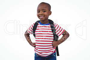 Standing boy with backpack smiling at the camera