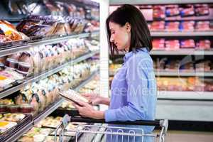 Smiling woman taking meal in the aisle