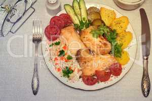 Baked fish and vegetables . The view from the top.