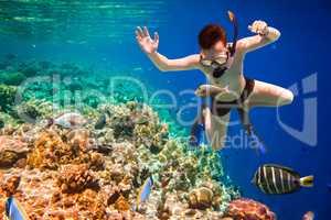 Snorkeler Maldives Indian Ocean coral reef.