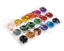 Used watercolor paints in palette isolated on white background