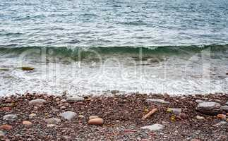 Pebble and stone beach with incoming wave