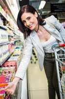 Smiling woman picking yoghurt