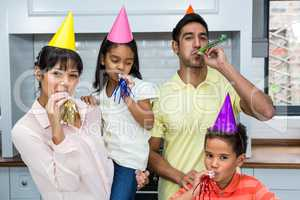 Happy family partying in the kitchen