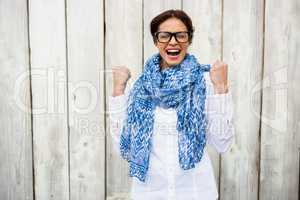 Happy hipster woman celebrating victory