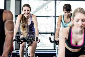 Fit women working out at spinning class
