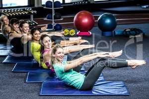 Fit smiling group working abs