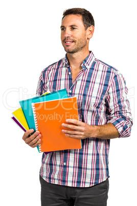 Smart man standing holding notepads