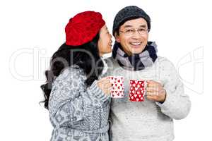 Older asian couple having hot drinks