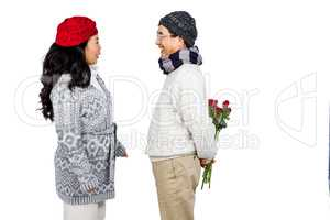 Older asian man giving his wife flowers