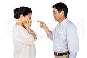 Older asian couple having an argument