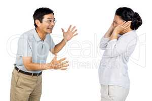 Older asian couple having an argument