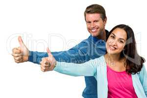 Portrait of smiling couple showing thumps up sign