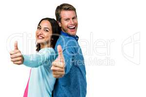 Smiling couple gesturing ok sign
