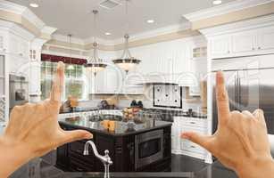 Hands Framing A Beautiful Custom Kitchen