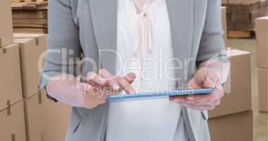 Composite image of close up of woman using tablet