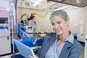 Composite image of portrait of smiling businesswoman using digit