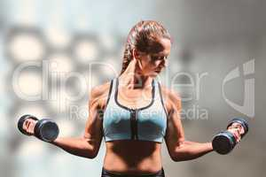 Composite image of sporty woman lifting dumbbells