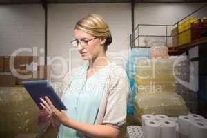 Composite image of university teacher using digital tablet