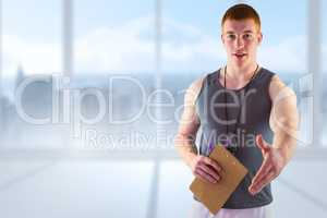 Composite image of welcoming personal trainer giving handshake