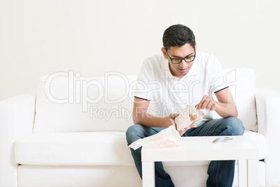 Lonely man eating food alone at home