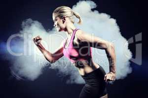 Composite image of muscular woman running in sportswear