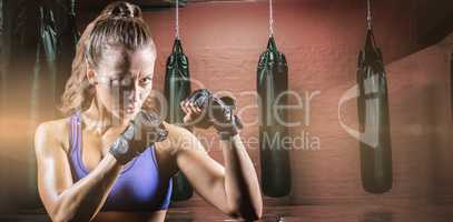 Composite image of portrait of female confident boxer with fighting stance