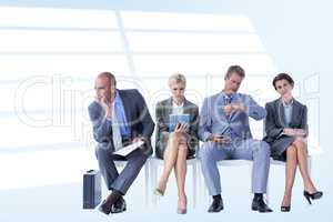 Composite image of business people waiting to be called into int