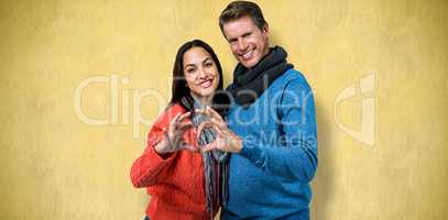 Composite image of portrait of couple making heart shape with ha