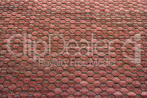 red hexagonal tiles on the roof as a background