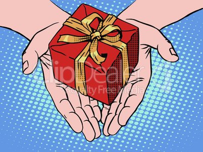 Male hands heart shape gift box